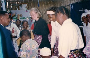 Me dancing in a church near Maputo (the man with the rooster is the Minister - and no, it wasn't sacrificed).  We'd been there for an AIDS presentation